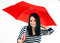 Stock Image : Young girl is protected from bad weather with a red umbrella