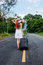 Stock Image : Young girl walking down the road
