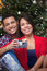 Stock Image : Young latin couple celebrating Christmas