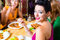 Stock Image : Young people eating in restaurant