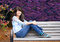 Stock Image : Young preteen girl sitting on park bench outdoors