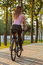 Stock Image : Young woman on bicycle