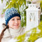 Stock Image : Young woman with Christmas lantern