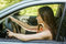 Stock Image : Young woman driving car
