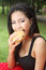 Stock Image : Young woman enjoying a chicken burger