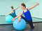 Stock Image : Young woman exercising with a ball
