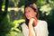 Stock Image : Young woman  among green trees