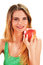 Stock Image : Young woman holding a red ripe apple in her hand