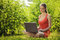 Stock Image : Young woman with laptop on green grass at park
