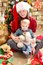 Stock Image : Young woman in a Santa hat and little boy.