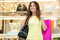 Stock Image : Young woman shopping in a mall