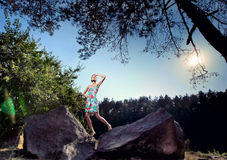 Girl on the rocks Royalty Free Stock Photography