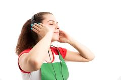Woman storekeeper or retail worker relaxing by listening music. Young woman storekeeper or retail worker relaxing by listening music in headphones as stock images