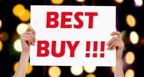 ¡Best Buy! Manos femeninas que llevan a cabo un cartel fotografía de archivo