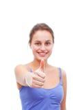 ¡Buen trabajo!! - Mujer joven que da los pulgares para arriba Imagen de archivo libre de regalías