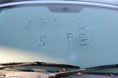 ¡Conduzca la caja fuerte! concepto para las condiciones atmosféricas heladas Fotografía de archivo