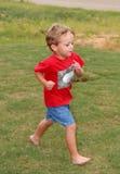 ¡Funcione con la corrida del muchacho! Fotos de archivo