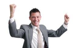 ¡Sí! la demostración joven, hermosa del hombre de negocios excitemen Imagenes de archivo