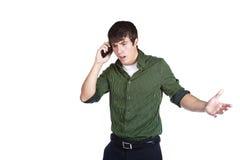 ¡WTF!?! Hombre joven enojado en el teléfono celular Fotografía de archivo