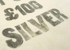 £100 versilbern gedruckt auf einer WeinleseBankeinlagebargeld-/-stoffgeldtasche Stockfotografie