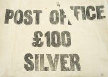 £100 zilver op een uitstekende het geldzak die van de Postkantoorbank wordt gedrukt Royalty-vrije Stock Foto