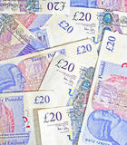 £20 Pound Notes. A pile of £20 (twenty pound) notes issued by the Bank of England Stock Photography