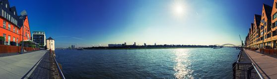 180 ° panorama of promenade on the Rhine in Cologne, Germany. Sunny sky with no clouds and sun reflection on the water. royalty free stock photos