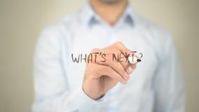¿Cuál es siguiente? , Escritura del hombre en la pantalla transparente Foto de archivo libre de regalías