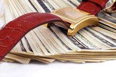 ¿O? reloj y dinero Imagen de archivo libre de regalías
