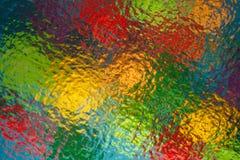 цветные предметы через рифлёное стекло.