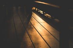 ฺBeautiful Złoty żółty światło słoneczne odbijał na drewnianej podłodze w ranku zdjęcie royalty free