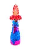 ชBeautiful flowers in glass bottle with hydrogel isolated on whit Royalty Free Stock Photo