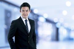 นThe executive businessman in black suit Royalty Free Stock Images