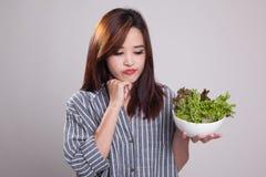 ๊้Unhappy Asian woman hate salad. Royalty Free Stock Photo