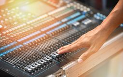 ้hand in Audio mixer sound Mix Control. Large Music Mixing desk equipment equipment sound mixer control stock photo