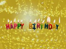 ้Happy birthday candles with light on sparkle star background. In celebration concept Royalty Free Stock Photos
