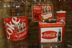 ๊A beautiful red Coca Cola bottle rests on a beautiful vintage wooden. Exhibition dedicated to Coca Cola. A beautiful red Coca Cola bottle rests on a stock photography