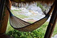 ็Hommock. Wooden hammock in front of rock mountain Royalty Free Stock Photography