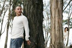 À cache-cache dans la forêt Photographie stock libre de droits