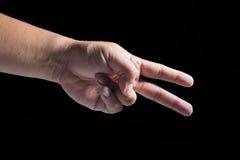 à ¹ ‰ Hand auf schwarzem Hintergrund Lizenzfreies Stockfoto