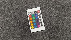à télécommande d'isolement sur le fond gris image stock