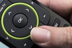 À télécommande tenu par une main Image stock
