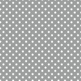 Às bolinhas brancos pequenos no cinza Fotografia de Stock Royalty Free