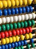 Ábaco con las bolas de madera coloreadas Imágenes de archivo libres de regalías