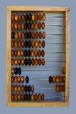 Ábaco de madeira em um fundo claro fotos de stock