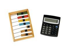 Ábaco y calculadora Imágenes de archivo libres de regalías