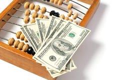 Ábaco y dólar Imagen de archivo libre de regalías
