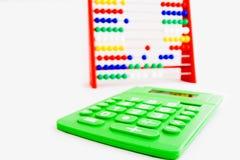 Ábaco y una calculadora Imagen de archivo libre de regalías