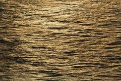 Água áspera na luz solar Foto de Stock
