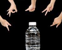 A água é boa, garrafa de água no fundo preto Fotos de Stock Royalty Free